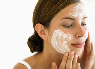 Young Woman Using Facial Cream